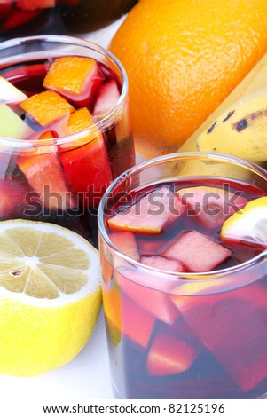 Sangria in glasses and fruits on table, closeup - stock photo