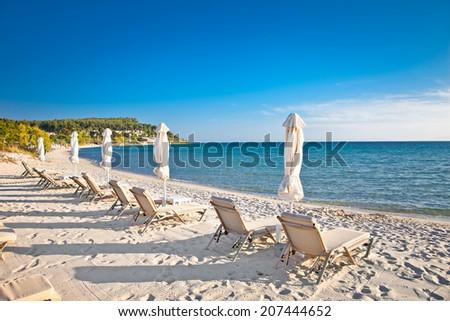 Sani sand beach on Kassandra peninsula, Halkidiki,  Greece. - stock photo