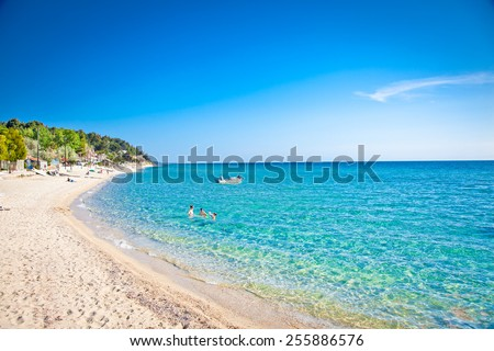 Sani sand beach on Kassandra peninsula, Halkidiki,  Greece. - stock photo