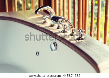 sanitary, hygiene, travel and tourism concept - close up of bathtub at exotic asian hotel