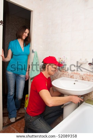 sanitary technician repairs a bowl - stock photo
