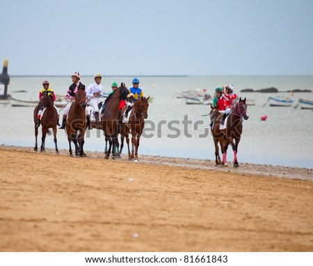 SANLUCAR DE BARRAMEDA, CADIZ, SPAIN - AUGUST 07: Unidentified riders at the start of the horses races of the beach of Sanlucar de Barrameda on August 07, 2010 in Sanlucar de Barrameda, Cadiz, Spain.