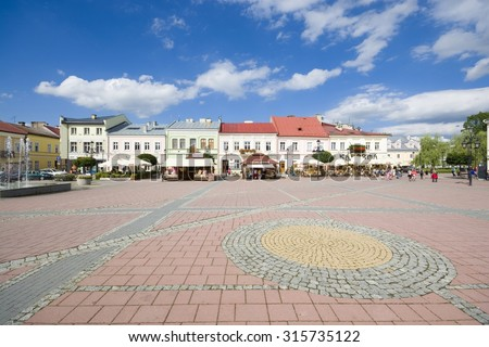 SANOK, POLAND - JULY 30: Market with tenement houses in the Old Town on July 30, 2015 in Sanok, Poland