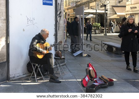 Sanremo Italy,  February 2016: Street musicians perform in the streets of the city during the week of the song festival - stock photo