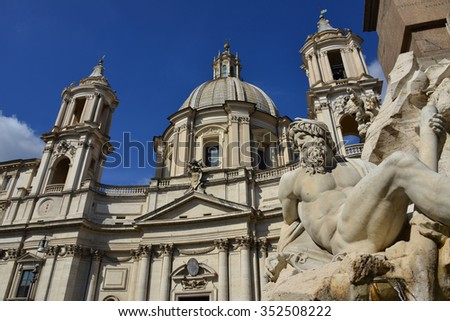 Santa Agnese Church and River Ganges statue from the beautiful Bernini's Fountain of Four River in the center of Piazza Navona Square, Rome  (17th century) - stock photo