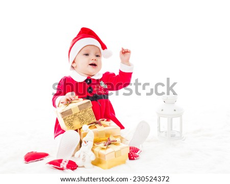 Santa baby girl with gift box and christmas decorations on a fur - stock photo