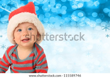 Santa baby in front of a blue Christmas background.