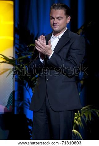 SANTA BARBARA, CA - JAN 30: Inception star, Leo Di Caprio, claps at the tribute for Christopher Nolan at the 26th Santa Barbara Int'l Film Festival on Jan 28, 2011 in Santa Barbara, CA. - stock photo