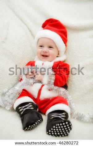 Santa boy on his first Christmas - stock photo