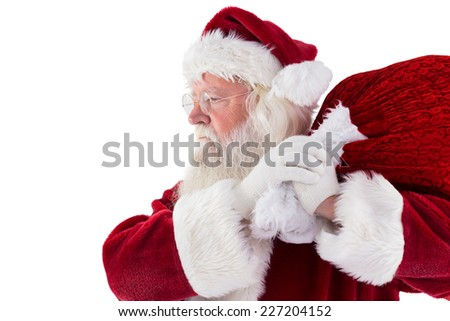 Santa carries his red bag on white background