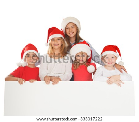 Santa children holding a blank placard - stock photo