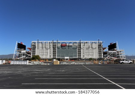 SANTA CLARA, CA - MARCH 18: Construction workers put the finishing touches on Levi�s Stadium on March 18, 2014. The stadium will be the new home of the San Francisco 49ers starting in the 2014 season. - stock photo