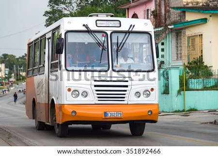 SANTA CLARA,CUBA-APRIL 5,2015: Old obsolete vehicles circulating in the Cuban streets. These transportation means are both a tourist attraction and a leading cause of death by accidents in the country - stock photo