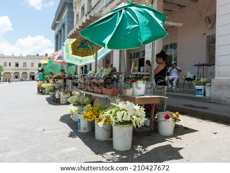 SANTA CLARA, CUBA-JUNE 28, 2014: Private flower stands. After the government economic reforms, citizens are conducting small business with more ease and legal peace of mind. - stock photo