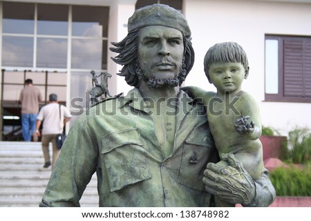 SANTA CLARA, CUBA - MARCH 29: statue of Guevara with a child in Santa Clara on March 29, 2006. This statue was made in 1997 to celebrate the entry of Guevara in Santa Clara on December 28, 1958.