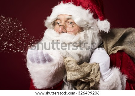 Santa Claus always brings snow and gifts - stock photo