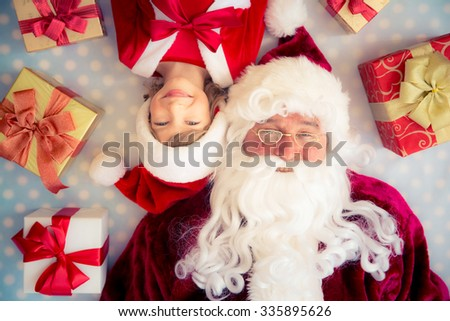 Santa Claus and child. Christmas gift. Xmas holiday concept. Top view - stock photo