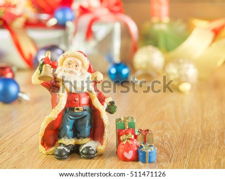 Santa Claus and gifts of box and colorful balls for happy festival