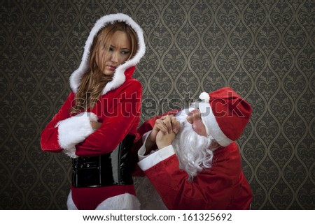 Santa Claus and Mrs. Santa is trying to solve problems with their relationships. - stock photo