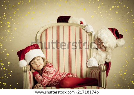Santa Claus and sleeping child. Children dream. Christmas holiday concept. Xmas miracle - stock photo