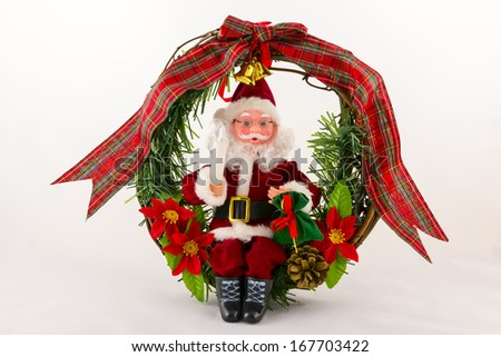 Santa Claus as singing toy on a white background - stock photo