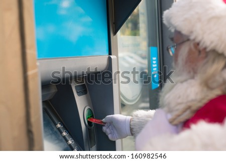 Santa Claus at Atm - stock photo
