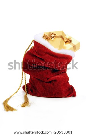 Santa Claus bag full of christmas presents over white background - stock photo