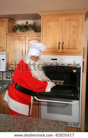 Santa Claus bakes cookies in his kitchen before christmas eve to share with his friends - stock photo