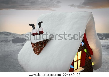 Santa claus boots against digitally generated snowy land scape - stock photo