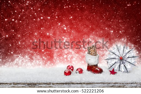Santa Claus boots and star in the snow