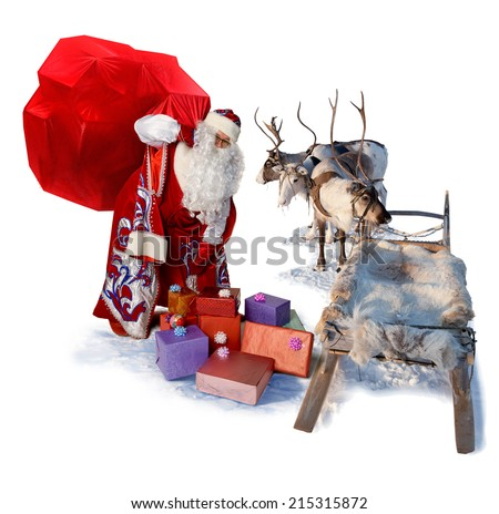 Santa Claus carries the big bag of gifts to his reindeer sleigh to give their all people during Christmas. Isolated on white background. - stock photo