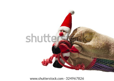 Santa Claus carrying big sack full of christmas presents, isolated, on white background, with copy space  - stock photo