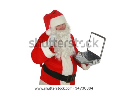 Santa Claus checks his computer isolated on white  room for text - stock photo