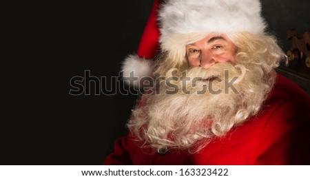 Santa Claus closeup portrait indoors in real life - stock photo