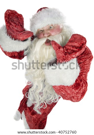 Santa Claus contorts funny mug on a white background