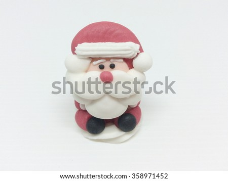 Santa Claus Doll made of colored sugar isolated on white - stock photo
