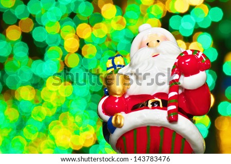 Santa Claus doll with Christmas illuminations - stock photo