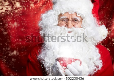 Santa Claus drinking tea Closeup Portrait Isolated on red Background