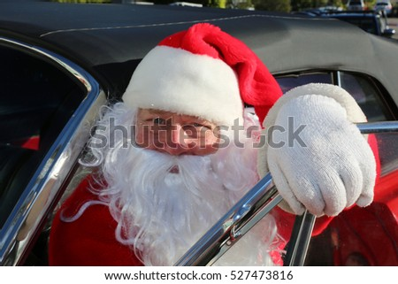 Santa Claus drives his Hot Rod Car.