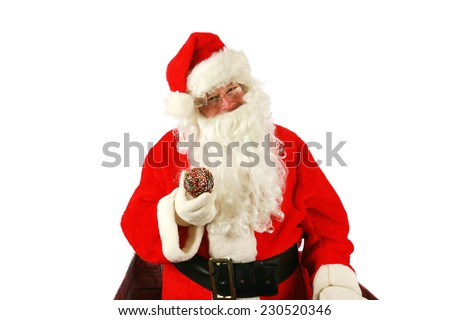 Santa Claus enjoys fresh baked piping hot donuts left for him as a thank you gift for all the nice presents he brings to good little boys and girls around the world. Santa loves donuts and stuff - stock photo