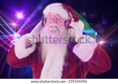 Santa Claus enjoys some music against digitally generated music symbol design - stock photo