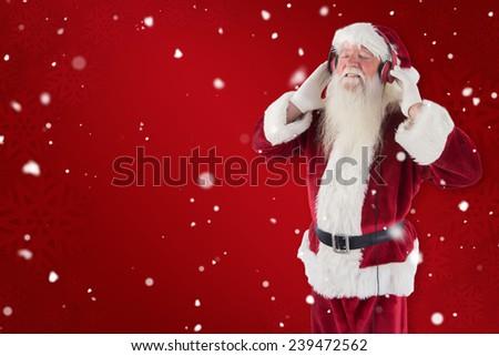 Santa Claus enjoys some music against red snowflake background - stock photo