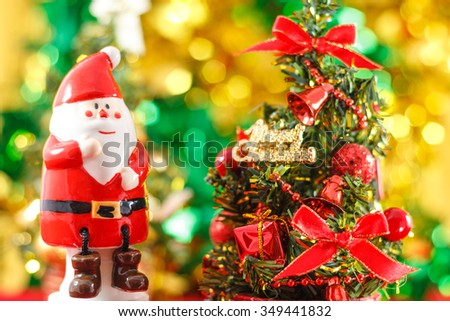 Santa Claus figurine with Christmas tree - stock photo