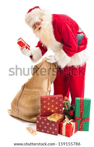 Santa Claus finally found the right gift in his gifts sack - stock photo
