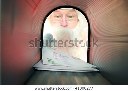 Santa Claus gets his mail from his mail box, as seen from the inside out - stock photo