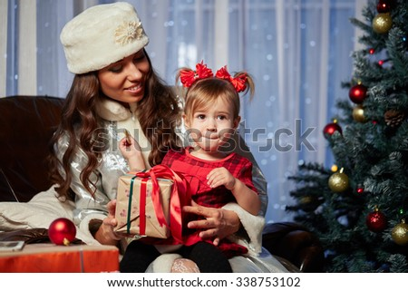 Santa Claus gives presents at the celebration Christmas