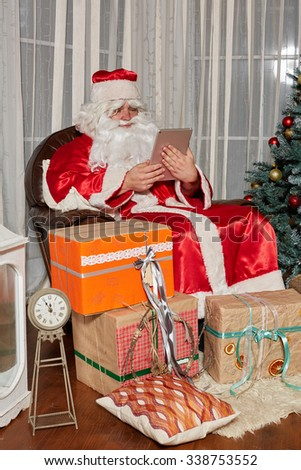 Santa Claus gives presents at the celebration Christmas - stock photo