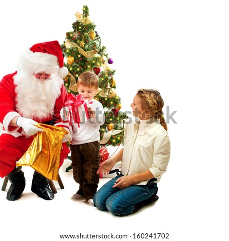 santa claus giving christmas gifts to children santa and happy kids sister and brother