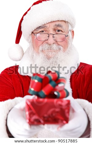 Santa Claus giving present for Christmas, close up, isolated on white background - stock photo