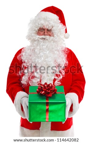 Santa Claus giving you a Christmas presents, isolated on a white background. - stock photo